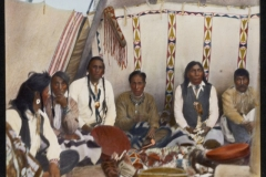 Seven-Indian-men-seated-inside-highly-decorated-tipi-McClintock-800-596